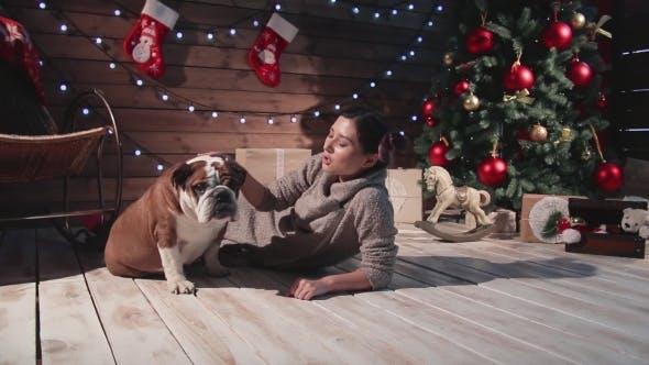 Thumbnail for Happy Woman And Bulldog At Christmas