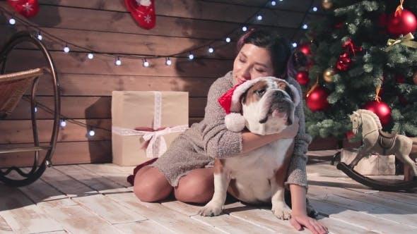 Thumbnail for Happy Woman And Her English Bulldog At Christmas
