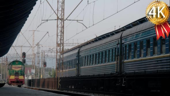 Thumbnail for Diesel Goods Locomotive Passing Through a Small