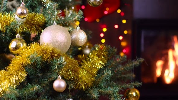 Thumbnail for Decorated Christmas Tree With Lights In Front Of Fireplace