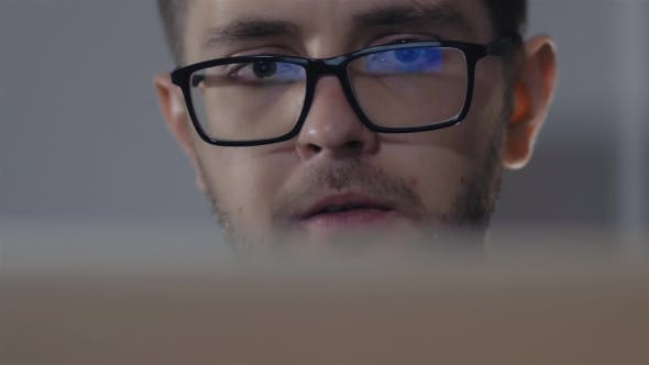 Thumbnail for Man In Black Rim Glasses Using His Computer In Office. Businessman With Screen Reflection In The