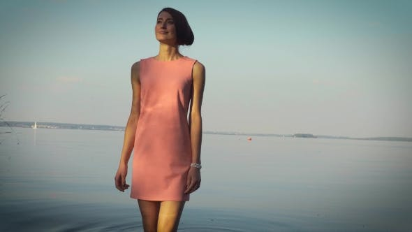 Thumbnail for Modest Girl Walking Near The Water Body