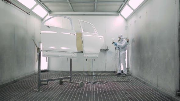 Thumbnail for The Man Paints a Car Door.
