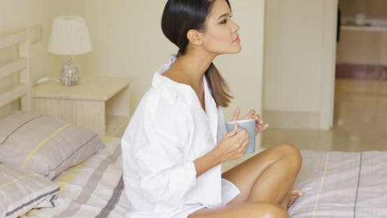 Thumbnail for Side View Of Calm Woman Enjoying Coffee In Bed