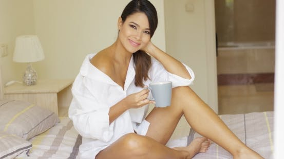 Thumbnail for Gorgeous Young Woman Drinking a Mug Of Coffee