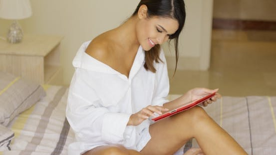 Thumbnail for Sexy Young Woman Sitting On Her Bed
