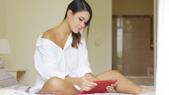 Thumbnail for Sexy Young Woman Relaxing With a Tablet Pc