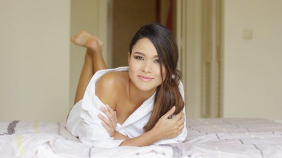 Thumbnail for Attractive Young Woman Lying On Her Bed