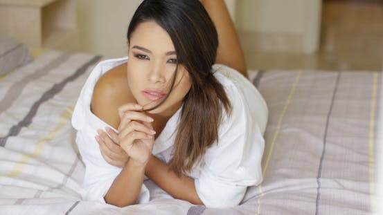 Thumbnail for Pensive Gorgeous Young Woman Lying On a Bed