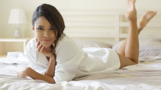 Thumbnail for Sexy Pretty Young Woman Lying On Her Bed