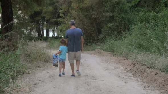 Thumbnail for Child Walking Through The Wood With Grandpa