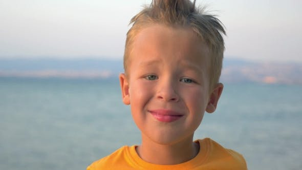 Little Blond Child On Sea Background