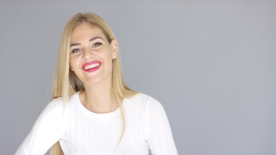 Thumbnail for Attractive Blond Woman With a Happy Smile