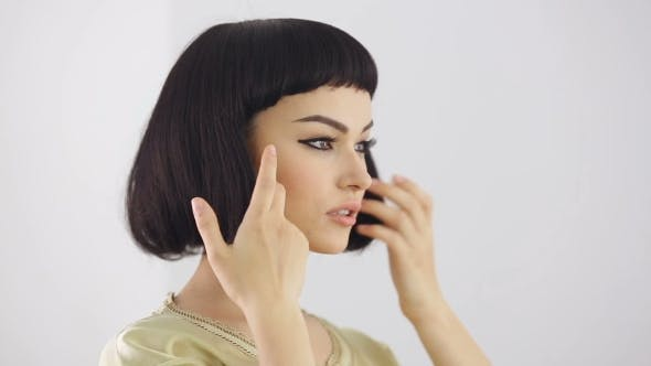 Preparations In Front Of The Mirror. Cleopatra's Make-up And Haircut Posing In Studio