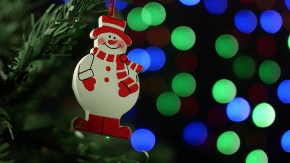 Thumbnail for Christmas Background With Christmas Tree And Snowman On Background Of Blurred Lights Garlands