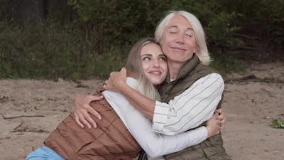Loving Mom and Daughter Embracing