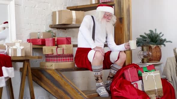 Thumbnail for Santa Claus Drinking Tea at Home