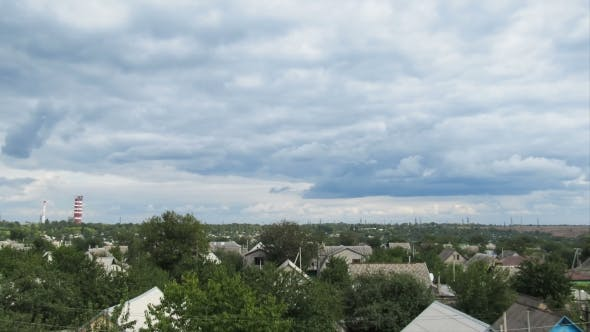 Thumbnail for Clouds In The Sky Moving Over The Houses In The City