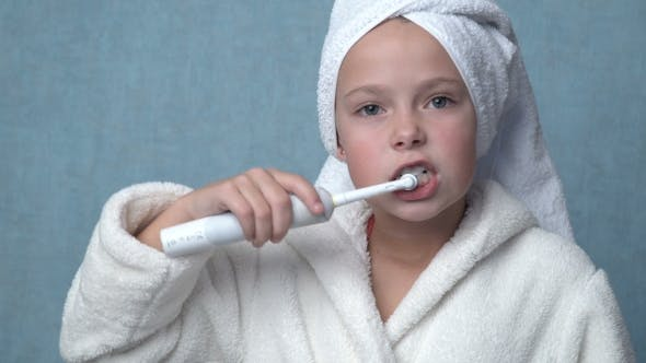 Cover Image for Girl Cleaning Teeth With Electric Toothbrush