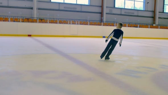 Thumbnail for Young Figure Skater Performs A Jump