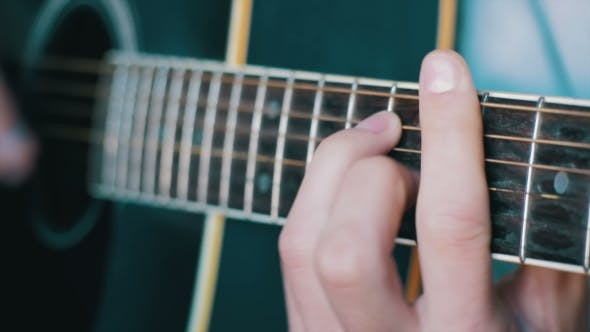 Thumbnail for Man Playing Acoustic Guitar
