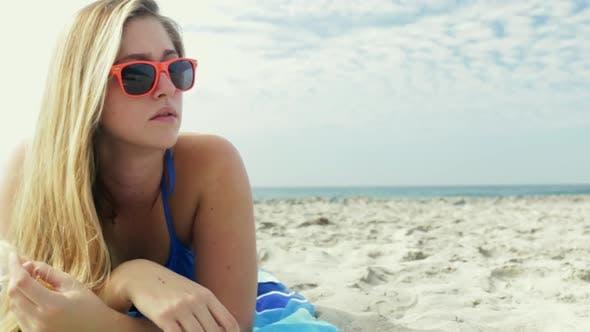 Thumbnail for Woman lying on beach