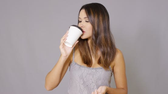 Thumbnail for Attractive Young Woman Drinking Takeaway Coffee
