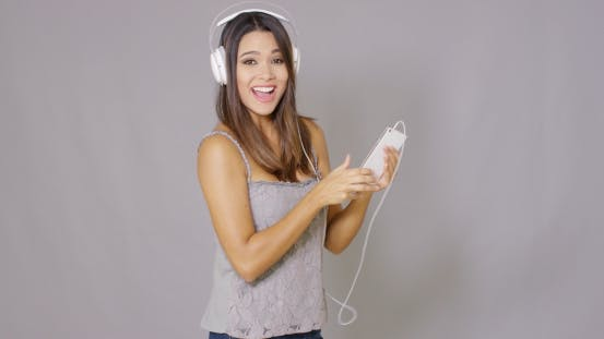 Thumbnail for Rapturous Young Woman Listening To Music