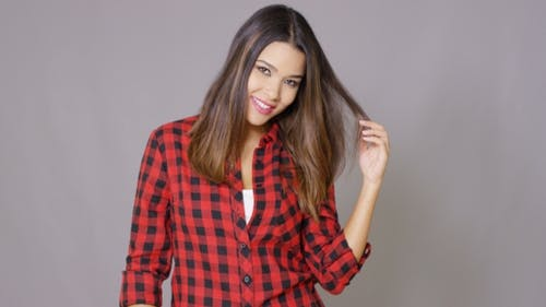 Single Woman Wearing Checkered Red And Black Shirt