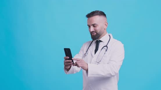 Thumbnail for Online Medical Consultation. Friendly Doctor Talking with Patient Via Cellphone Video Chat