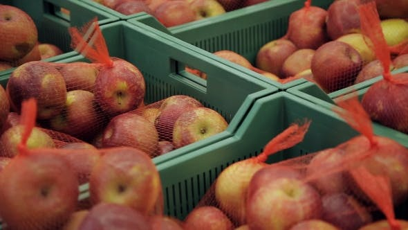 Cover Image for Fresh Fruits In a Market. Apples In Boxes In Supermarket