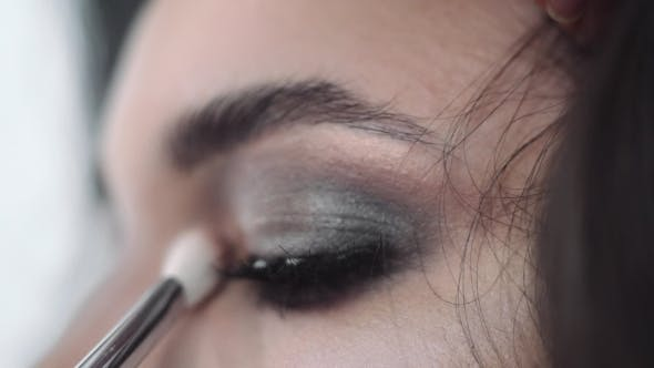 Thumbnail for Make Up Stylist Makes Smokey Eyes Effect For Woman At Photo Shoot