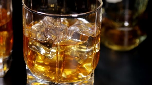 Cover Image for Glasses Of Malt Whiskey On a Black Table
