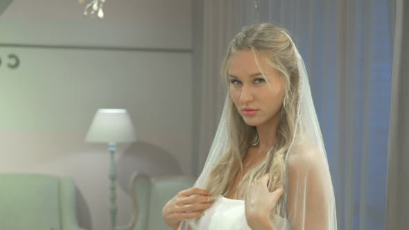 Thumbnail for Blonde In Dress Posing On Camera In Wedding Salon