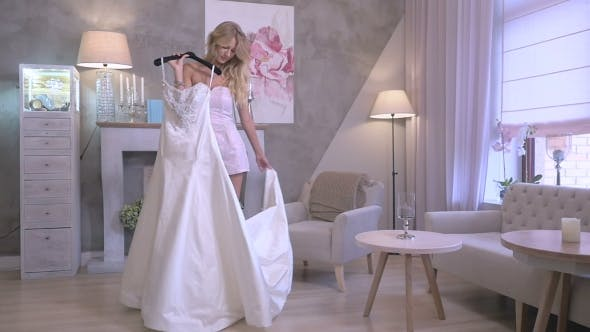 Thumbnail for The Girl Dancing With Wedding Gown In Boutique