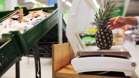 Thumbnail for Woman Weighing Pineapple On Scale At Grocery Store 2