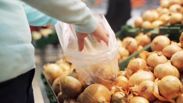 Thumbnail for Woman Putting Onion To Bag At Grocery Store 5