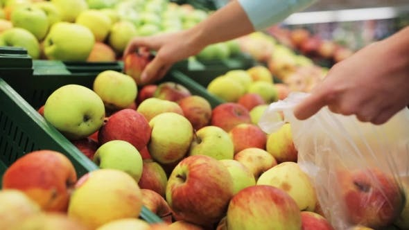 Thumbnail for Woman Putting Apple To Bag At Grocery Store 7