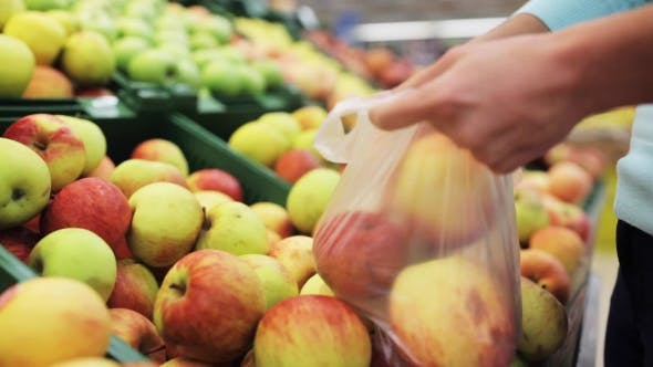 Thumbnail for Woman Putting Apple To Bag At Grocery Store 8