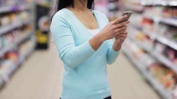 Thumbnail for Woman With Smartphone At Supermarket Or Store 13