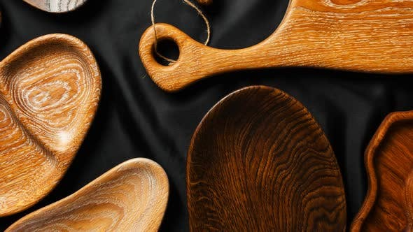 Thumbnail for Rich Variety of Wooden Empty Cutting Boards and Plates on Dark Background.