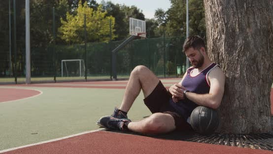 Thumbnail for Young Basketball Player Checking His Activity on Smartwatch