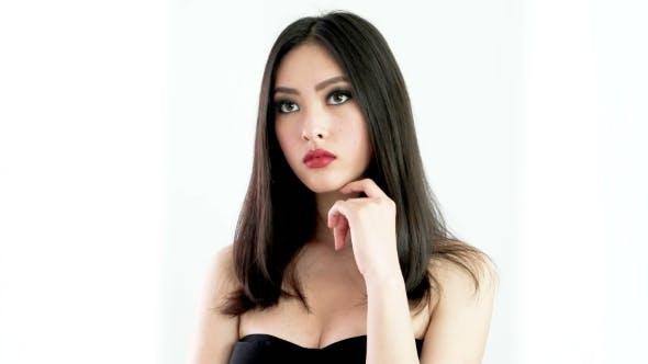 Thumbnail for Studio Fashion Shot Of Asian Woman