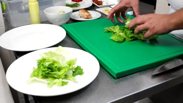 Thumbnail for Lettuce, Salad Leaves Chef Puts On a Plate, Professional-kitchen, The Chef Prepares a Caesar Salad