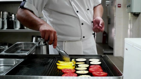 Thumbnail for Chief-cooker Prepares Vegetables On Professionally Grilled, Cook Tongs For Grill Flips Ingredients