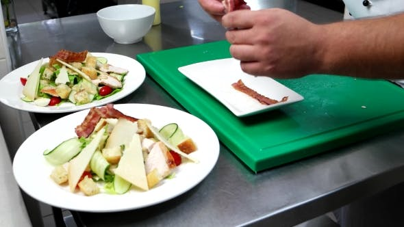 Cover Image for Chef Put The Slices Of Bacon On The Chopped Vegetables, Parmesan, Cheese, Chicken, Cherry Tomatoes