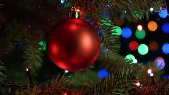 Thumbnail for Christmas And New Year Decoration. Christmas Tree Decorations Red Ball With Blurred Fairy Lights