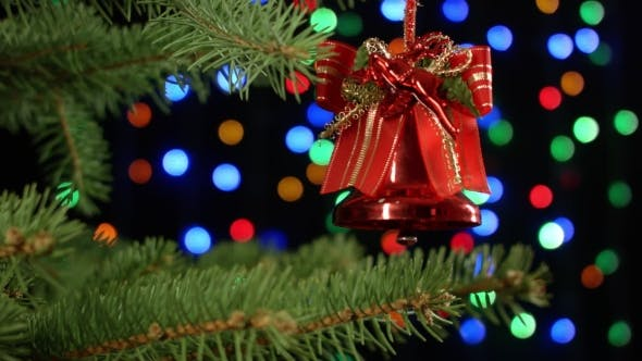 Thumbnail for Christmas Bell For Tree Decoration On Holiday Background Colorful Blurred Garlands