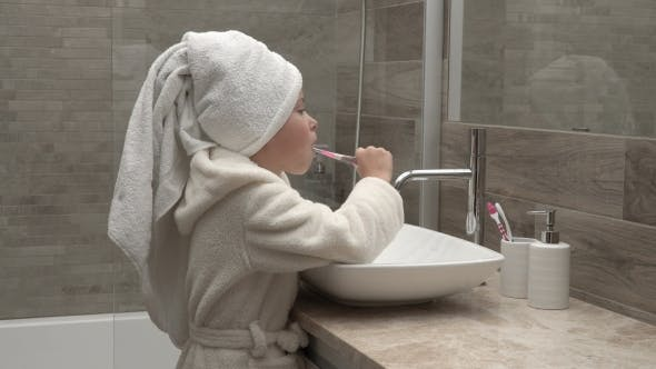 Thumbnail for Girl In a Towel And a Bathrobe Cleaning Teeth, 3 clips in 1