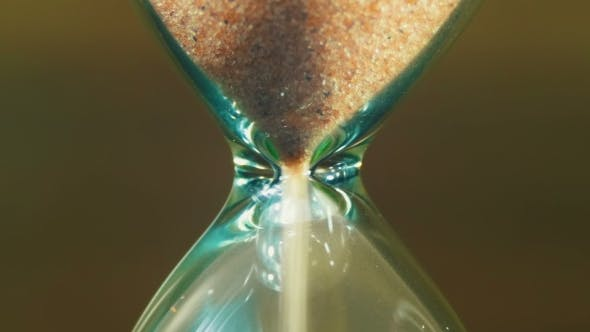 Thumbnail for Hourglass On a Wooden Background, The Sand Falls Inside